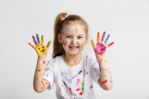 Young kid showing her colorful hands