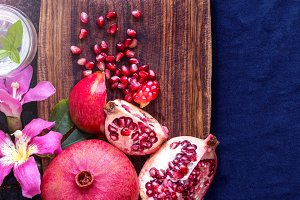 Pomegranate fruit with flowers, flat