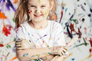 Smiling little girl with painting br
