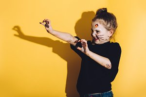 Young child with cat make up strechi