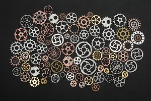 Bunch of cogwheels on black backgrou