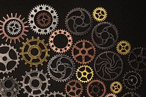 Bunch of cogwheels on a black backgr