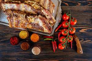 raw marinated pork ribs and tomatoes