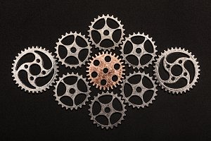 Rose-gold cogwheel surrounded by met