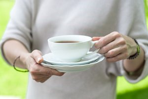 Cup of tea in woman hands
