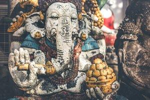 Hindu god lord Ganesha statue on the street in Ubud, Bali island.