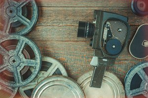 Old movie camera and film reel