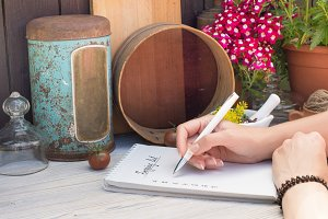 Woman writing shopping list