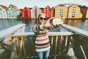 Happy smiling woman taking selfie