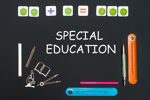 Above stationery supplies and text special education on black background