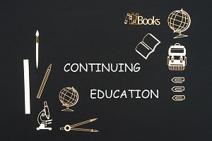 School supplies placed on black background with text continuing education