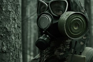 Young man in gas mask
