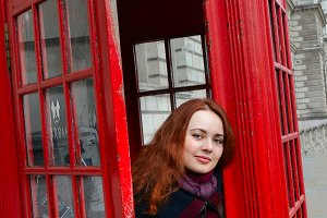 London girl by red phone booth