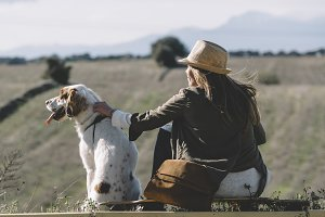 Blond woman with hat and pet.