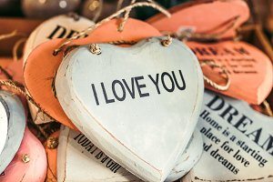 Wooden hearts with romantic text. Souvenir shop on Bali island.