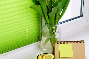 Yellow tulips, tea and coffee