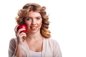 Girl with holding red apple