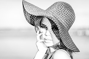 Nice girl in a hat. Black and white