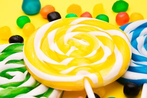 colorful spiral lollipops on colorfu