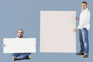 Men holding blank space boards (PSD)