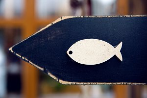 white fish pattern on wooden