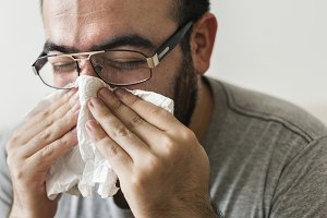 People with a cold and high fever