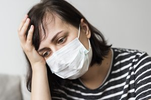 Woman with a cold and high fever