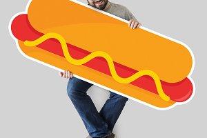 Man holding a hot dog