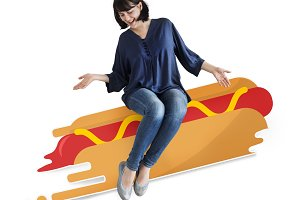 Woman sitting on a hot dog