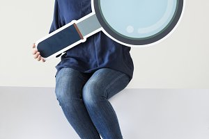 Woman holding a magnifying glass