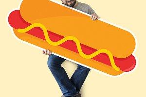 Man holding a big hot dog (PSD)