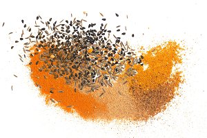 many spices including Ginger Curry Turmeric Chili pepper Black cumin Nigella sativa over white