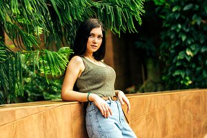 beautiful girl in jeans in the tropi