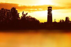 Horizontal lighthouse sunset landscape background