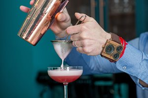 bar counter, bartender and cocktails