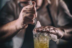 Barman mixing a cocktail