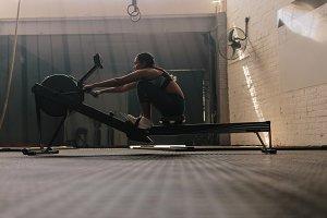 Female athlete using rowing machine