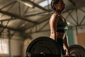 Muscular woman doing heavy weight