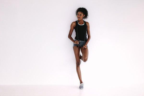 Slim african woman standing