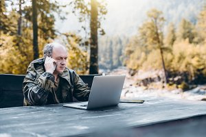 Gamekeeper with laptop, outdoors