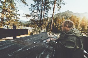 Forester outdoors with the laptop