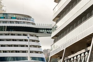Detail of two large cruise ships in harbor in Funchal