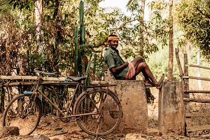 indian man resting on fence