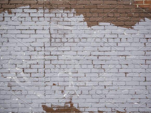 Painted grungy brick wall texture.