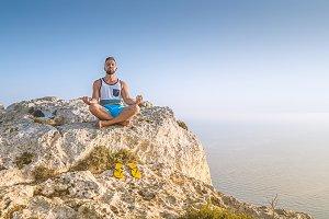 Man making lotus pose and meditating