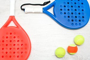 paddle tennis racket and balls