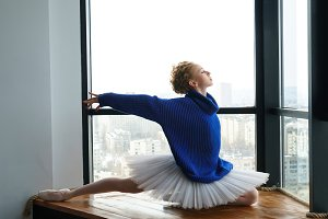 Ballerina in woolen sweater