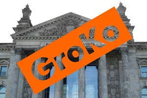 Groko (Grosse Koalition) over Reichstag parliament in Berlin