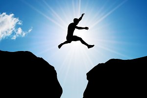 Man jumping over precipice