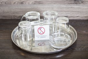 Glass cups with a plate No smoking.
